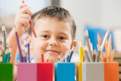 child choosing coloured pencils